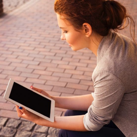 Young woman looking at a tablet